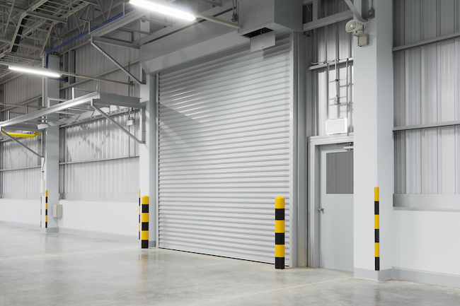 Perth Roller shutter garage door and concrete floor outside factory building for industrial Perth background.