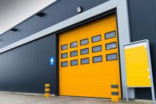 yellow industrial garage door in Perth Western Australia