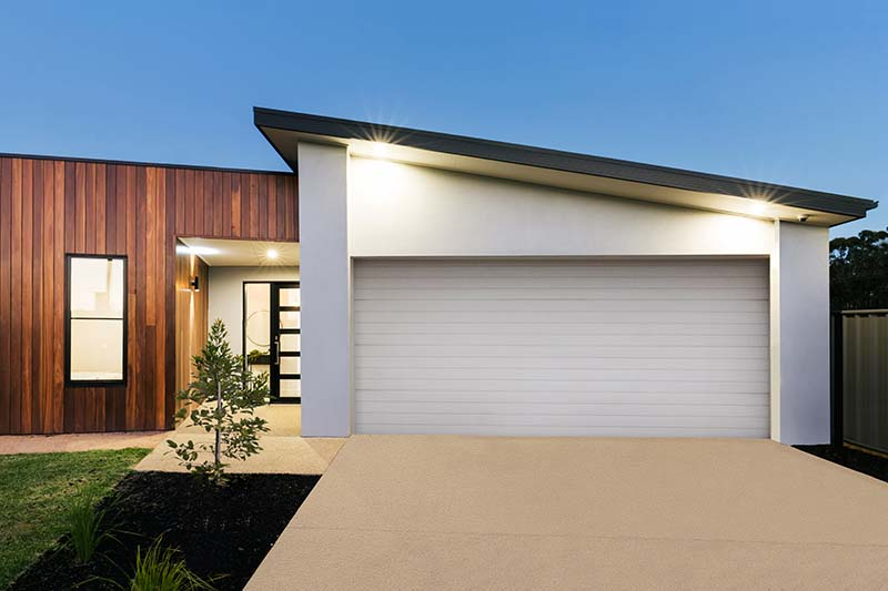 Perth Garage doors installation and replacement.Workers installing lifting system
